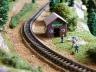 Railroad men moving railroad ties.